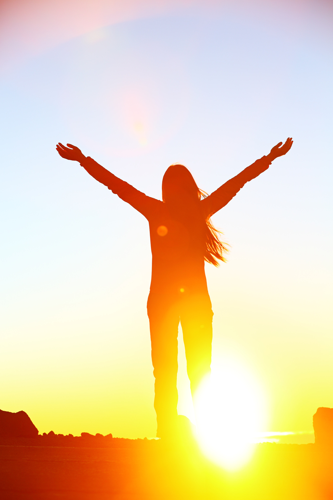 Happy cheering celebrating success woman sunset